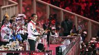 Presiden Joko Widodo tersenyum saat memberikan sambutan sekaligus membuka secara resmi PON Papua di Stadion Lukas Enembe, Kompleks Olahraga Kampung Harapan, Distrik Sentani Timur, Kabupaten Jayapura, Papua, Sabtu (2/10/2021). (ANTARA FOTO via InfoPublik/Nova Wahyudi)