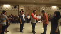 Penyerahan SK kenaikan pangkat PNS di Pemkab Gresik, Jawa Timur (Foto: Liputan6.com/Dian Kurniawan)
