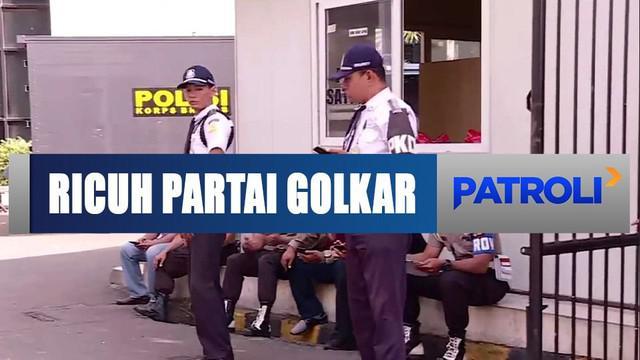 Usai perebutan kantor DPP Partai Golkar, polisi masih berjaga-jaga di depan gedung DPP.