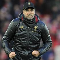 Pelatih Liverpool, Juergen Klopp, saat melawan AFC Bournemouth pada laga Premier League di Stadion Anfield, Sabtu (9/2). Liverpool menang 3-0 atas AFC Bournemouth. (AP/Rui Vieira)