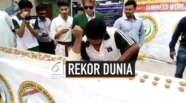 Pria bernama Rashid Naseem berhasil memecahkan rekor baru. Ia  mampu menghancurkan 229 kenari dengan menggunakan sikunya.