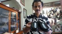 Jan Ethes, cucu pertama Presiden Joko Widodo, tak mau ketinggalan gaya saat pernikahan Kahiyang Ayu dan Bobby Nasution. Foto: Fajar Abrori/ Liputan6.com.