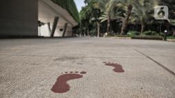 Suasana Lapangan Banteng saat ditutup sementara di Jakarta, Kamis (15/9/2020). Lapangan Banteng dan hutan kota lainnya di Ibu Kota Kembali ditutup sementara selama penerapan pembatasan sosial berskala besar (PSBB) Jakarta guna menekan penyebaran Covid-19 di ruang publik. (merdeka.com/Iqbal Nugroho)