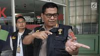 Ketua Tim Media Satgas Antimafia Bola Kombes Pol Argo Yuwono memberi keterangan pers terkait penggeledahan kantor PSSI di FX Tower, Jakarta, Rabu (30/1). Penggeledahan merupakan pengembangan dari laporan tersangka sebelumnya. (Liputan6.com/Faizal Fanani)