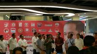 Jokowi menutup pameran foto relawan Jokowi di Plaza Atrium Senen (Nanda Perdana Putra/Liputan6.com)