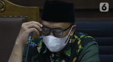 Terdakwa kasus suap dana hibah Kemenpora kepada KONI, Imam Nahrawi saat menjalani sidang lanjutan di Pengadilan Tipikor Jakarta, Rabu (18/3/2020). Sidang lanjutan mantan Menteri Pemuda dan Olahraga Imam Nahrawi ini menyimak keterangan saksi-saksi. (Liputan6.com/Helmi Fithriansyah)