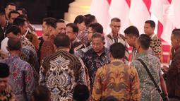 Menko Perekonomian Darmin Nasution ketika menghadiri Debat Capres di Hotel Sultan, Jakarta, Minggu (17/2). Debat mengusung tema pangan, energi, infrastruktur, sumber daya alam, dan lingkungan hidup. (Liputan6.com/Faizal Fanani)