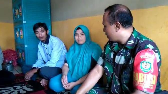 Keluarga Iriawan, salah satu korban selamat penyerangan insiden Nduga, Papua (Liputan6.com/Jayadi Supriadin)