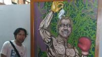 Seniman Bengkulu menciptakan lukisan untuk menyindir koruptor.