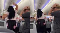 Pasangan kekasih bertengkar di kabin pesawat. (dok. Twitter)