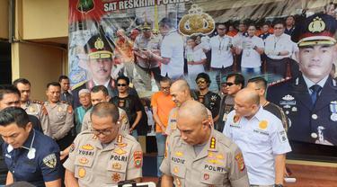 Polisi menangkap Tohab Silaban, pencekik polisi lalu lintas di Tol Angke 2, Jakarta Barat.