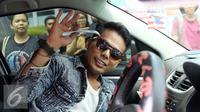 Muncikari Robby Abbas akhirnya menghirup udara bebas dan keluar dari LP Cipinang, Jakarta, Selasa (10/5/2016). [Foto: Herman Zakharia/Liputan6.com]