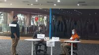KPK gelar rekonstruksi kasus suap Bansos covid-19 di  gedung KPK, Jakarta. (Liputan6.com/Fachrur Razi)