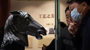 Patung kepala kuda yang dijarah dari China's Old Summer Palace 160 tahun silam telah kembali ke 'rumah' asalnya (Xinhua/Li He)