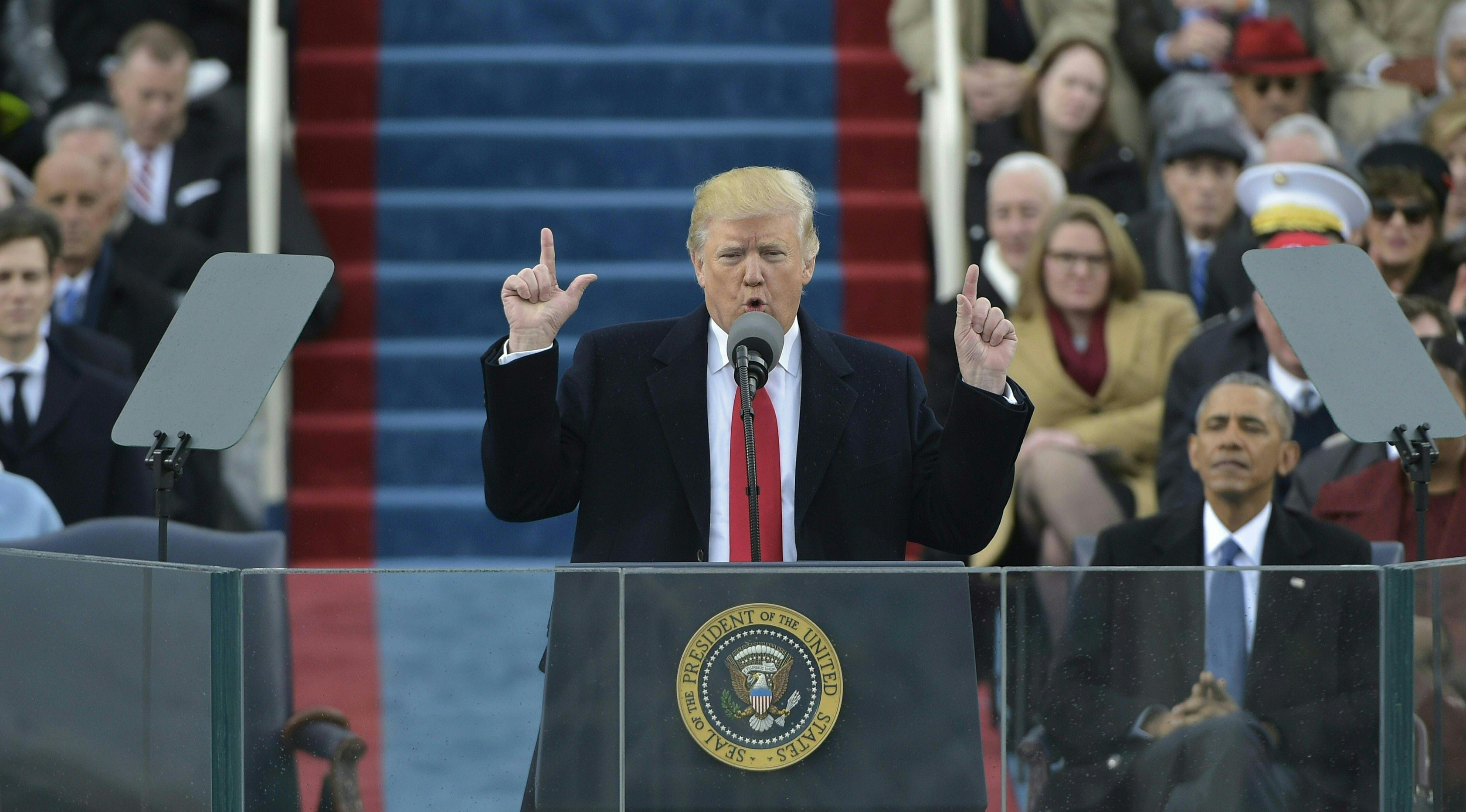 Donald Trump mendapat tempat untuk memberi pidato perdana sebagai Presiden AS di Capitol Hill, Washington DC, AS, Jumat (20/1). Dalam pidatonya, Trump meyakinkan warga Amerika bahwa dirinya tidak akan mengecewakan warga Amerika. (AFP Photo)