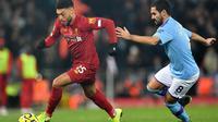 Aksi Ilkay Gundogan saat membela Manchester City pada laga melawan Liverpool. (AFP/Paul Ellis)
