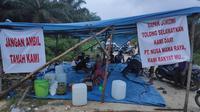 Petani lahan plasma di Kabupaten Pelalawan mendirikan tenda sebagai perlawanan eksekusi kebun sawit mereka. (Liputan6.com/M Syukur)