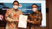 Menpora  RI Zainudin Amali menerima Penyerahan Laporan Hasil Pemeriksaan (LHP), Pemeriksaan atas Laporan Keuangan Kemenpora RI Tahun 2019 di Auditorium Wisma Kemenpora, Senayan, Jakarta, Rabu (22/7).