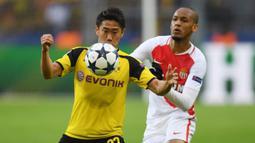 3-6. Shinji Kagawa. Gelandang asal Jepang ini telah mencetak 11 gol dalam penampilannya bersama Borussia Dortmund pada musim 2010/2011 dan 2011/2012 dan Manchester United pada musim 2012/2013 dan 2013/2014. Pada musim ini ia bermain untuk klub Yunani, PAOK Athens. (AFP/Patrik Stollarz)