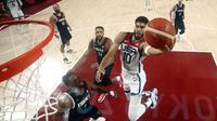 Tak mau kalah, bintang muda NBA asal Boston Celtics Jayson Tatum juga bikin 19 poin dan 7 rebound saat mengalahkan Prancis di final basket putra Olimpiade Tokyo 2020. (Foto: AP/Pool/Gregory Shamus)