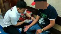 PNS DPRD Bantaeng, Sulsel, ini bersama kekasihnya ditangkap polisi saat hendak pesta sabu. (Liputan6.com/Fauzan)