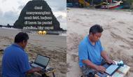 Kisah suami yang menemani keluarga liburan di pantai sambil kerja. (@kien7177/tiktok.com).
