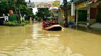 Kondisi di Perumahan Villa Nusa Indah 1 dan 2 Desa Bojongkulur, Kecamatan   Gunungputri, Kabupaten Bogor yang kembali terendam banjir, Senin (8/2/2021) pagi. (Liputan6.com/Achmad Sudarno)