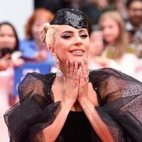 Lady Gaga bermain di film A Star Is Born bersama Bradley Cooper.  (AP Photo/Nathan Denette)