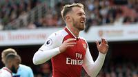 Aaron Ramsey memiliki kelebihan mencetak gol saat penyerang The Gunners kesulitan menerobos pertahanan lawan. Ramsey bisa menjadi solusi Arsene Wagner saat melawan Chelsea pada Derby London. (John Walton/PA via AP)
