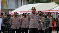 Kepala Baharkam Komisaris Jenderal Agus Andrianto ketika berkunjung ke posko karhutla Riau dan Covid-19. (Liputan6.com/M Syukur)