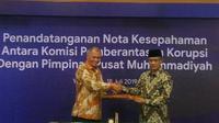 PP Muhammadiyah dan KPK RI menandatangani MoU pencegahan tindak korupsi di Kantor PP Muhammadiyah Yogyakarta, Kamis (18/7/2019). (Liputan6.com/ Switzy Sabandar)