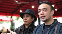 """Rencananya mau melaporkan Tessa atas beberapa dugaan pelanggaran. Untuk lebih jelasnya nanti ya kami katakan selesai laporan,"" kata  M Firdaus OIwobo di Reskrimsus Polda Metro Jaya. (Adrian Putra/Bintang.com)"