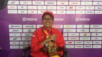 Pecatur Indonesia, Nasip Farta Simanja, meraih dua medali emas pada Asian Para Games 2018, di Cempaka Putih, Jakarta, Rabu (10/10/2018). (Bola.com/Benediktus Gerendo Pradigdo)