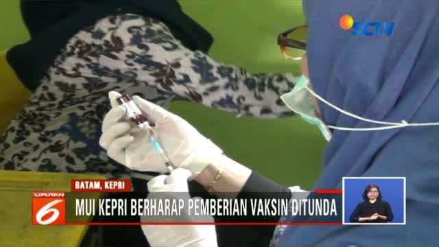 MUI Kepulauan Riau meminta penundaan vaksin karena belum jelasnya status halal atau haramnya vaksin.