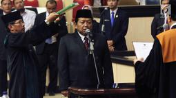 Wakil Ketua DPD terpilih Akhmad Muqowam mengucap sumpah jabatan saat dilantik, Jakarta, Kamis (26/7). Pemilihan ini merupakan kelanjutan dari berlakunya UU Nomor 2 Tahun 2018 tentang MPR, DPR, DPD, dan DPRD (UU MD3). (Liputan6.com/Johan Tallo)