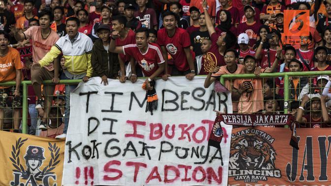 Ilustrasi suporter Persija Jakarta, The Jakmania. (Bola.com/Vitalis Yogi Trisna)