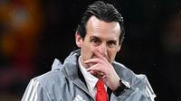 Ekspresi Manajer Arsenal Unai Emery saat menyaksikan anak asuhnya bertanding melawan Eintracht Frankfurt pada pertandingan Liga Eropa di Stadion Emirates, London, Inggris, 28 November 2019. Kekalahan Arsenal di Liga Europa mempercepat proses pemecatan Emery. (DANIEL LEAL-OLIVAS/AFP)