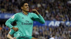 Bek Real Madrid, Raphael Varane  berselebrasi usai mencetak gol ke gawang Real Zaragoza pada pertandingan Copa del Rey (Piala Raja) di stadion La Romareda di Zaragoza (29/1/2020). Real Madrid melaju mantap ke perempatfinal Copa del Rey setelah mengalahkan Zaragoza 4-0. (AFP Photo/Jose Jordan)