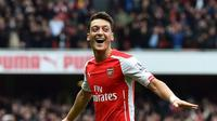 Gelandang Arsenal, Mesut Oezil. (AFP PHOTO / BEN STANSALL )