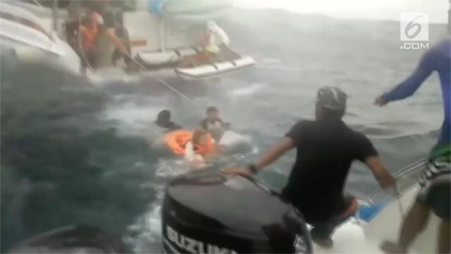 Upaya penyelamatan 14 turis asal Spanyol di Thailand. Mereka terombang ambing di laut lepas karena  kapal yang ditumpangi mengalami gangguan teknis.