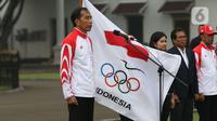 Presiden Joko Widodo atau Jokowi saat upacara pelepasan Kontingen Indonesia untuk SEA Games 2019 Filipina di Istana Bogor, Jawa Barat, Rabu (27/11/2019). Sebanyak 841 atlet Indonesia akan bertanding pada SEA Games Filipina di 51 cabang olahraga. (Liputan6.com/Angga Yuniar)