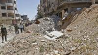 Penampakan terowongan yang sebelumnya digunakan oleh pemberontak di Jobar, Ghouta Timur, Senin, (2/4). (LOUAI BESHARA/AFP)