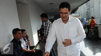 M. Nazaruddin tersangka Wisma Atlet saat akan mengikuti sidang vonis di pengadilan Tipikor, Jakarta,Rabu (15/6) Nazarudin divonis 6 tahun penjara denda 1 miliar subsider 1 tahun. (Liputan6.com/Helmi Afandi)