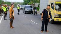 Antisipasi Napi Rutan Siak Kabur, Pintu Masuk ke Pekanbaru Dijaga Ketat Polisi (Foto: Liputan6/ M Syukur)