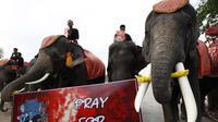 Gajah di Thailand mengikuti pawai menghormati korban kebakaran Australia.