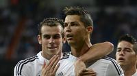 Manchester United disarankan mendatangkan Gareth Bale atau Cristiano Ronaldo untuk meraih gelar juara Premier League 2015-16. (AFP/GERARD JULIEN).