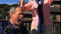 Tantangan itu merupakan hadiah Bush untuk Clinton yang baru saja merayakan ulang tahun ke 68.