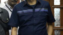 Advokat Lucas jelang sidang dakwaan di Pengadilan Tipikor, Jakarta, Rabu (7/11). Lucas didakwa menghalangi proses penyidikan KPK terhadap tersangka mantan petinggi Lippo Group, Eddy Sindoro. (Liputan6.com/Helmi Fithriansyah)