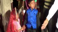 Tak ada keceriaan menghiasi wajah lugu anak-anak pada acara pernikahan anak massal di Rajasthan, India utara.