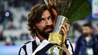 Ac Milan patut gigit jari melepas Andrea Pirlo ke klub rival Juventus. Pantas saja karena sejak kedatangan Pirlo, membuat Juventus sukses merengkuh gelar Serie A dan Coppa Italia (AFP/Giuseppe Cacace)